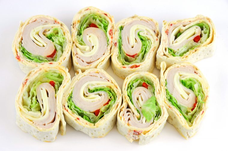 tortilla deli wrap rolls with turkey vegetable isolated on white background