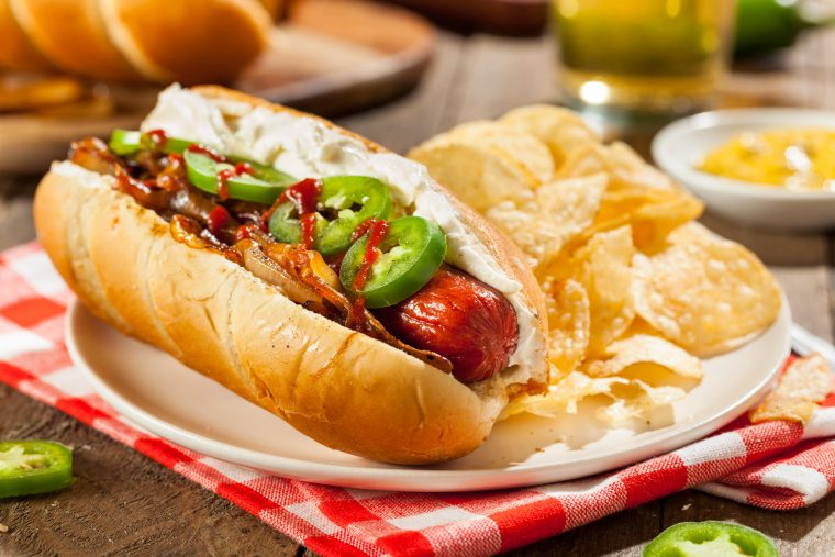 seattle style hot dog with cream cheese, jalapeños, Sriracha and grilled onions